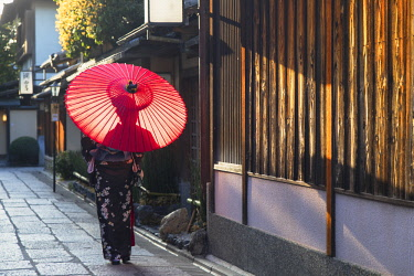 JAP1385AW Woman in kimono walking along alleyway, Kyoto, Kansai, Japan (MR)