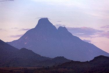 RW1276 Rwanda, Kinigi, Virunga National Park.  Mount Mikeno is a dormant volcano in Congo (DRC).  It is the second highest peak of the Virunga volcanoes, home to the critically endangered Mountain Gorillas.