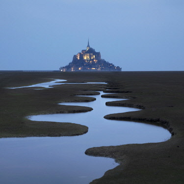 FRA10318AW A meandering pool and Mont Saint Michel at night, Manche, Normandy, France