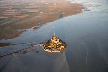 FRA10323AW Aerial view of Mont Saint Michel, at sunrise,  Manche, Normandy, France