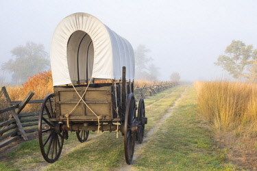 US48BBR0370 Whitman Mission National Historic Site, Washington State, USA. The replica wagon is displayed along the ruts of the Oregon Trail.