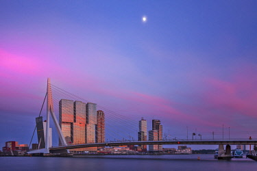NLD0821 The cable-stayed Erasmusbrug designed by Ben van Berkel and the De Rotterdam Building designed by the Architect Rem Koolhaas, at twilight, Erasmusbrug, Rotterdam, Zuid Holland, The Netherlands.