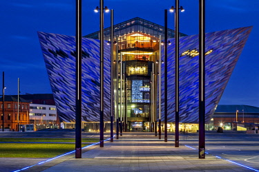 NIR8922 Rear view of the  Titanic Maritime Museum designed by the architects Eric Kuhne and Associates and the remains of the dry docks, where the Titanic and Olympic Liners were built at twilight, Titanic Qu...