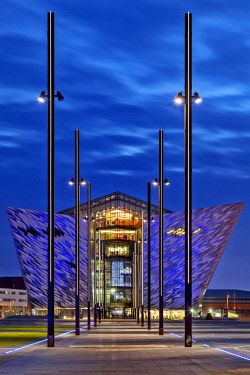NIR8924 Rear view of the  Titanic Maritime Museum designed by the architects Eric Kuhne and Associates and the remains of the dry docks, where the Titanic and Olympic Liners were built at twilight, Titanic Qu...