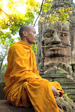 CMB1620AW Southeast Asia, Cambodia, Siem Reap, Angkor temples, Buddhist monk in saffron robes meditating (MR)