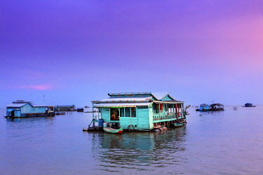 CMB1619AW Southeast Asia, Cambodia, floating houses on Tonle Sap lake at sunset