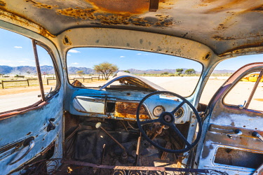 NAM6482AW Solitaire, Namibia, Africa. Abandoned rusty car in the desert.