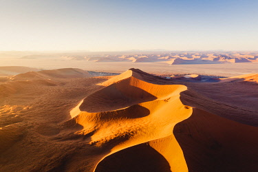 NAM6491AW Sossusvlei, Namib-Naukluft National Park, Namibia, Africa. Aerial view of the sand dunes at sunrise.