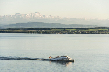 IBLDJS04635792 View of Lake Constance with excursion boat, in the back the Swiss Alps with Santis, near Meersburg, Baden-Wurttemberg, Germany, Europe