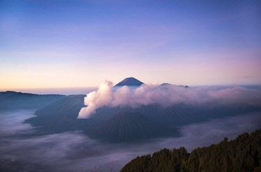 IBLMAB04629545 View of Caldera Tengger with volcanoes at sunrise, smoking volcano Gunung Bromo, with Mt. Batok, Mt. Kursi, Mt. Gunung Semeru, National Park Bromo-Tengger-Semeru, Java, Indonesia, Asia