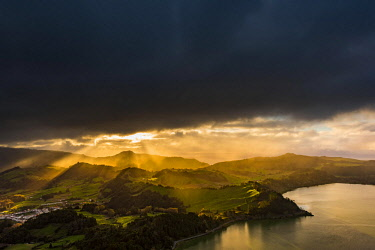 IBXSEI04644342 Furnassee with hilly landscape and dramatic atmospheric lighting, dark clouds, Furnas, Sao Miguel, Azores, Portugal, Europe