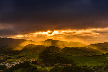 IBXSEI04644348 Hilly landscape and dramatic atmospheric lighting, dark clouds, Furnas, Sao Miguel, Azores, Portugal, Europe