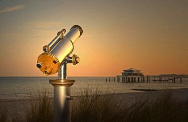 IBXIKN04629199 Telescope at Timmendorfer Strand, Teehaus auf Seebrücke at sunrise, Baltic Sea, Schleswig-Holstein, Germany, Europe
