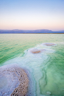 ISR0566AWRF Israel, South District, Ein Bokek. Salt deposits in the Dead Sea at sunset.