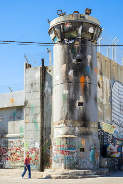 ISR0499AW Palestine, West Bank, Bethlehem. A lookout tower covered in graffiti along the Israeli West Bank Barrier wall.