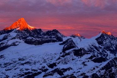 IBXSHU04456199 Zinalrothorn with snow in red dawn glow, Gornergrat, Zermatt, Canton of Valais, Switzerland, Europe