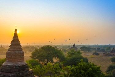 IBXVFW04399212 View of pagodas with hot air balloons, temples, sunrise, haze, morning light, Bagan, Division Mandalay, Myanmar, Asia