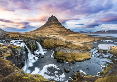 IBXMMW04402461 Mount Kirkjufell with Kirkjufellsfoss Waterfall, cloudy atmosphere, Grundarfjdraur, Snafellsnes peninsula, Vesturland, Iceland, Europe