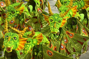 IBXFLK04345255 Dancers dressed as dragons, parade of the samba school Estacio de Sao, Carnival 2016 in the Sambadrome, Rio de Janeiro, Brazil, South America