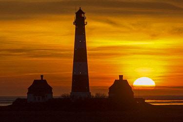 IBLNAO04304908 Westerheversand Lighthouse at sunset, Westerhever, Eiderstedt, North Frisia, Schleswig-Holstein, Germany, Europe