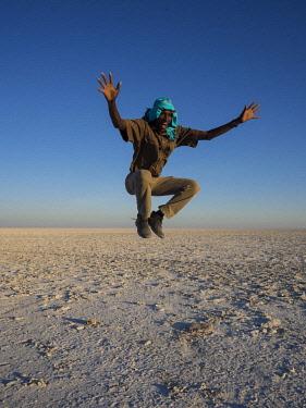 IBLOOC04426438 African man jumping, Makgadikgadi Pan, Botswana, Africa