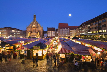 IBLMAN04446562 Nuremberg Christmas Market with Church of Our Lady at full moon, night scene, Nuremberg, Middle Franconia, Franconia, Bavaria, Germany, Europe
