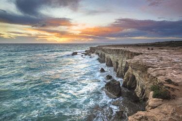 CLKAB84894 Cyprus, Ayia Napa, The sea caves at Cape Greco at sunset