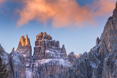 CLKFV87047 Blue sky and red clouds on the rocky peaks of the Rosengarten massif in winter Dolomites Bolzano South Tyrol Italy