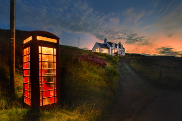 CLKFV85719 Red telephone box in a remote place on the the Isle of Skye, Scotland
