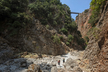 GRE1637 Greece, Crete, Aradhena Gorge. A narrow road bridge crosses the sheer Aradhena Gorge near Aradhena village. The gorge is a popular hiking route leading down to the coast.