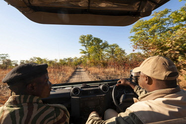 ZAM8107 Zambia, South Luangwa National Park, A safari vehicle drives along a sandy track.