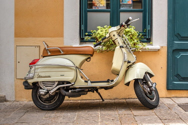 FRA10348AW Old Vespa scooter parked in a street, Ceret, Pyrenees-Orientales, France