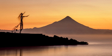 CHI11054AW Princess Licarayen Sculpture and Osorno Volcano at dawn, Puerto Varas, Llanquihue Province, Los Lagos Region, Chile