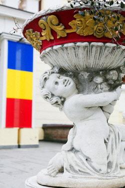 ROM1456 Eastern Europe, Romania, Sibiu, ornate flower pot and Romanian flag