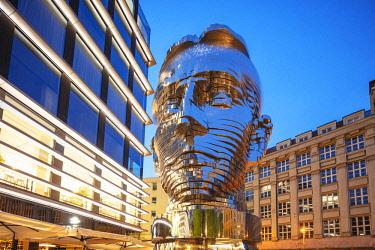 CZE1953 Europe, Czech Republic, Bohemia, Prague, rotating head statue of Czech writer Franz Kafka, by David Cerny at the Quadrio shopping center