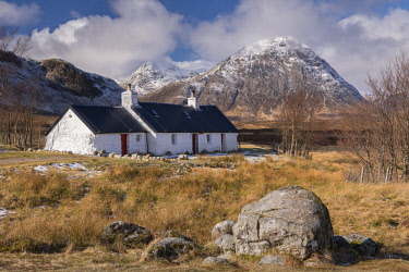 SCO35272AW Crofters Cottage on Rannoch Moor, with the famous Buachaille Mor mountain in the background, Scottish Highlands, Scotland. Winter (March) 2017.