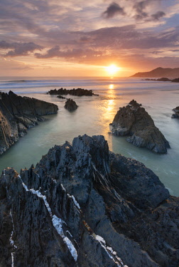 ENG15747AW Sunset over Combesgate Beach on the North Devon coast, England.