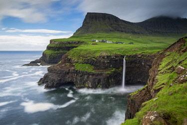DEN0376AW Waterfall cascading over cliffs at Gasadalur in the Faroe Islands, Denmark. Summer (June) 2017.