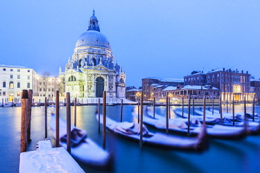 ITA13063 Venice. Veneto. Italy. Church of Santa Maria Maggiore  on the Gran Canal with gondolas covered in snow.