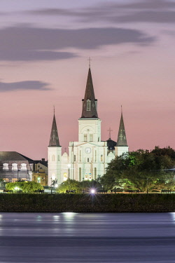USA12593AW United States, Louisiana, New Orleans. New Orleans skyline, view of Saint Louis Cathedral from across the Mississippi River at dusk.