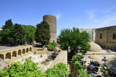 AZE0114AWRF The Maiden Tower (Qiz Qalasi), a 12th century monument in the Old City, and Haji Bani Bath complex (Haji Gayib's bathhouse), a UNESCO World Heritage Site. Baku, Azerbaijan