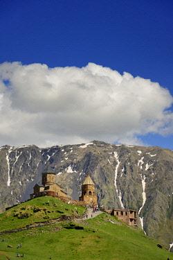 GEO0358AWRF Gergeti Trinity Church (Tsminda Sameba) dating back to the 14th century. Khevi-Kazbegi region. Georgia, Caucasus