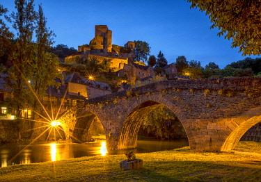 FRA10394AW Chateau Belcastel & 15th Century Bridge over Aveyron River at Night, Belcastel, Occitanie, France