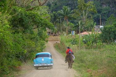 HMS3048760 Cuba, Pinar del Rio province, Vinales, Vinales national park, Vinales valley, a UNESCO World Heritage site, horse ride