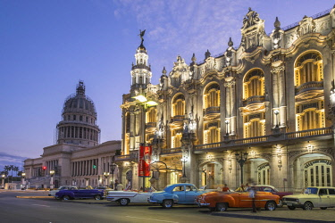 HMS3116065 Cuba, Havana, Habana Vieja district (UNESCO World Heritage site), Paseo de Marti or Prado, avenue lined with elegant mansions and it connects the Malecon to the Capitol, old American cars parked in fr...