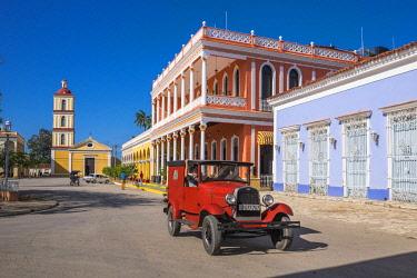 HMS3119971 Cuba, Villa Clara province, colonial city of Remedios founded in the 16th century, Plaza Mayor, Camino del Principe boutique hotel and Nuestra Senora del Buen Viaje church in the background