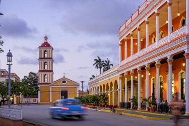 HMS3119989 Cuba, Villa Clara province, colonial city of Remedios founded in the 16th century, Plaza Mayor, Camino del Principe boutique hotel and Nuestra Senora del Buen Viaje church in the background