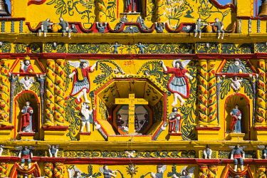 HMS2502776 Guatemala, Totonicapan department, San Andres Xecul, the most famous church in the country, the lemon yellow facade illustrates the syncretism between Catholicism and Mayan cosmogony, mixing angels, b...