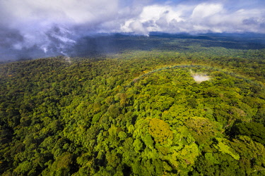 HMS2476694 France, Guyana, French Guyana Amazonian Park, heart area, overlooking the Amazon plain since the tabular chain of Mount Itoupe (830 m), rainy season, aerial view from helicopter transport of the scien...