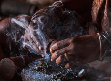 NAM6570AW Africa, Namibia, Damara Land. Preparing traditional Himba perfume